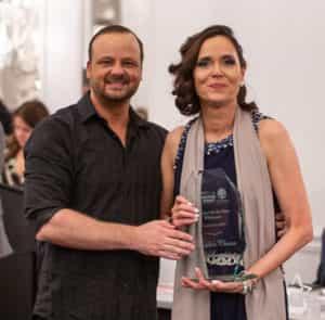 Debra Henley holding her award.